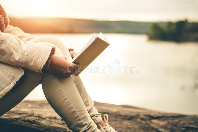 Women in winter sit read favorite book in the holiday. royalty free stock image