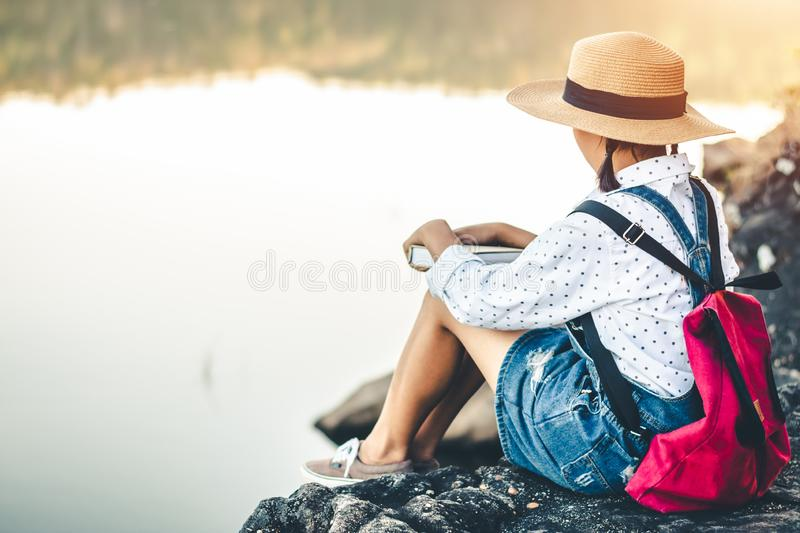 Women in winter sit read favorite book in the holiday. Women in winter sit read favorite book in the holiday, Concept girl reading a book stock image