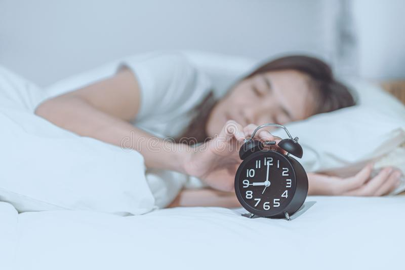 Woman woke up late on the morning of Monday. Women woke up late on the morning of Monday stock photo