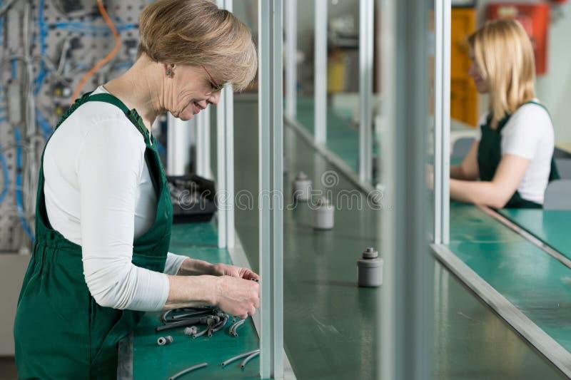 Women working in factory. Horizontal view of women working in factory stock photo
