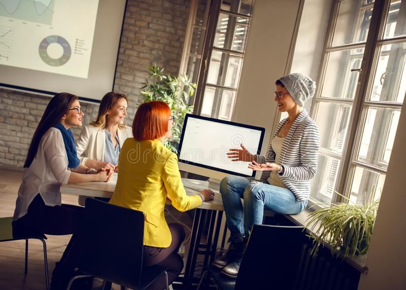 Women at workplace presents ideas for business royalty free stock images