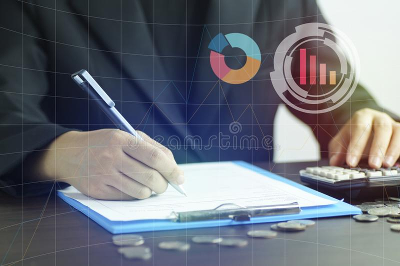 Women writing on note book and pressing calculator in book finance and banking, concept for background.concept in grow and walk st. Ep by step for success in stock photos