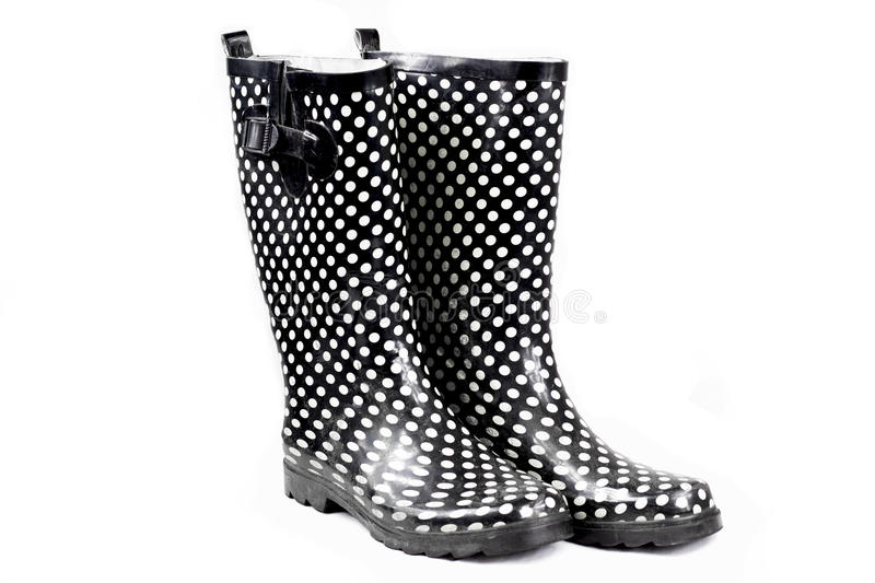 Womans rain boots. Womens black polka dot rain boots royalty free stock images