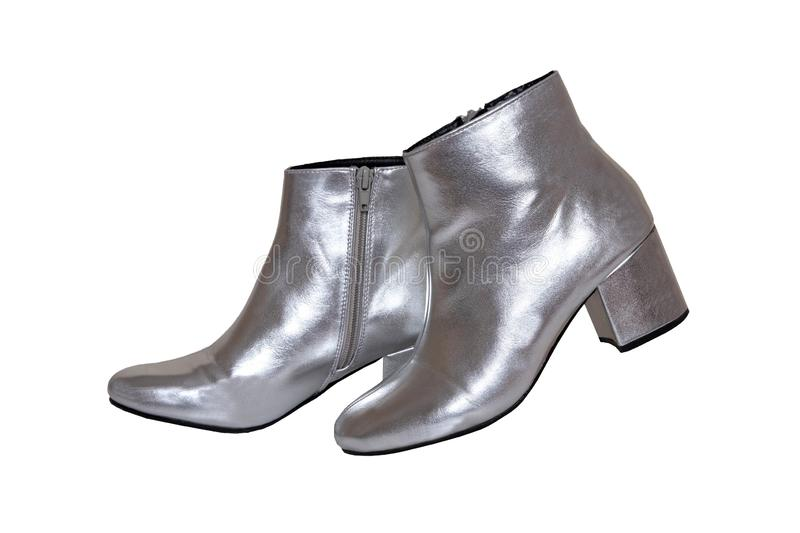 Womens boots and shoes. A pair female silver boots isolated on a white background. Leather shoe fashion new collection 2019. Isoliert royalty free stock image