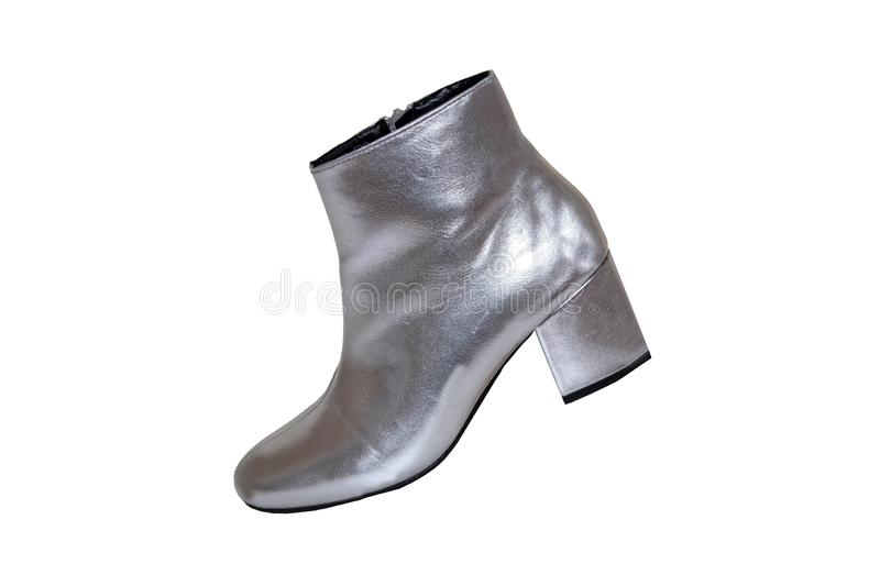 Womens boots and shoes. A pair female silver boots isolated on a white background. Leather shoe fashion new collection 2019. Objekte stock photo