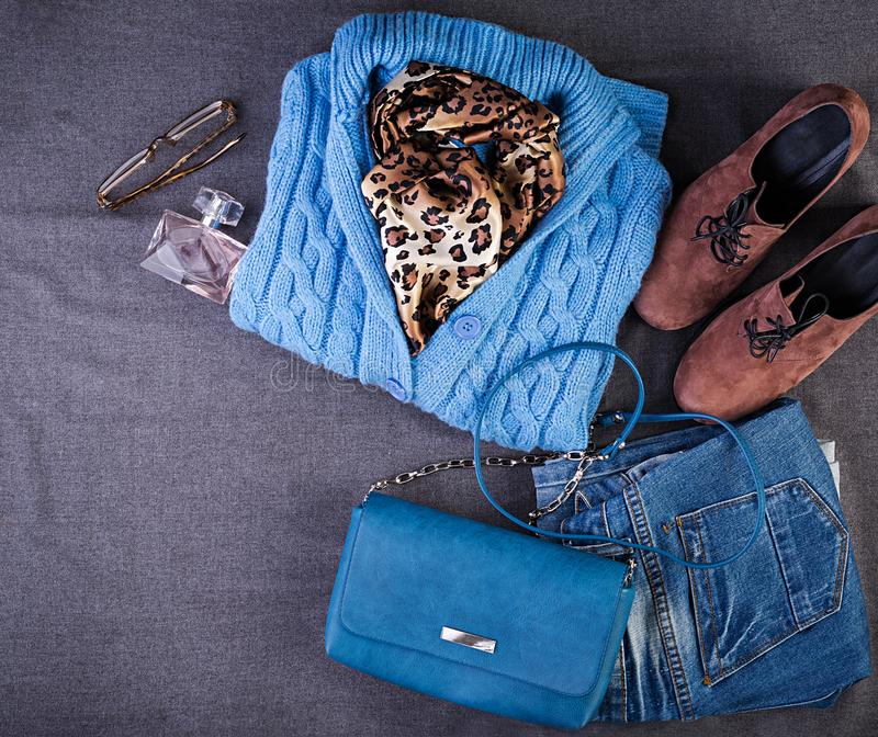 Womens clothing, accessories, footwear blue blouse, jeans, terracotta shoes, bag. Fashion outfit. Shopping concept. Top view. Womens clothing and accessories royalty free stock images