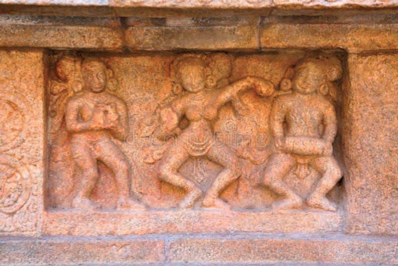 Womens dancing to music, motifs on the plinth, Airavatesvara Temple complex, Darasuram, Tamil Nadu. India stock photo