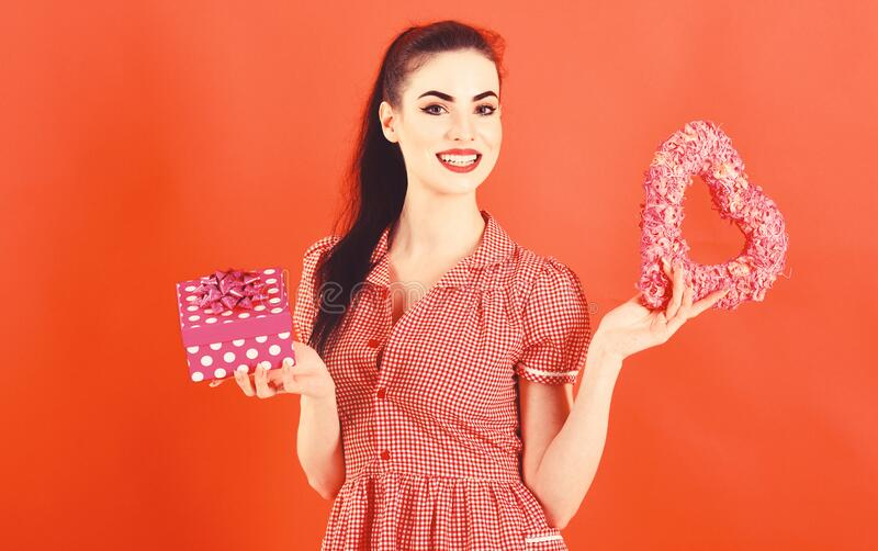 Womens day concept. Happy girl receives presents at Womans day. stock image