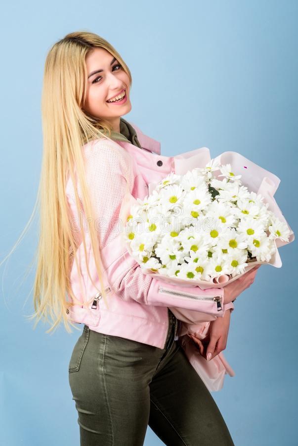 Womens day. Pretty girl. mothers day. Spring and summer. happy birthday present. Marguerite. florist in flower shop. Beautiful woman with daisy flower bouquet stock image