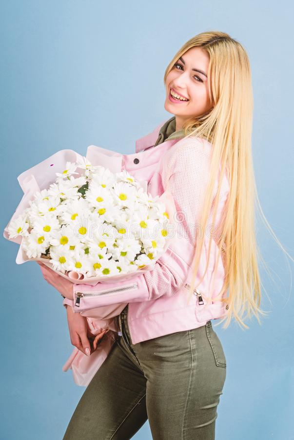 Womens day. Pretty girl. mothers day. Spring and summer. happy birthday present. Marguerite. florist in flower shop. Beautiful woman with daisy flower bouquet stock photography