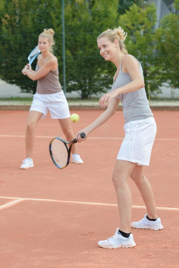 Womens doubles tennis game. Women stock photos