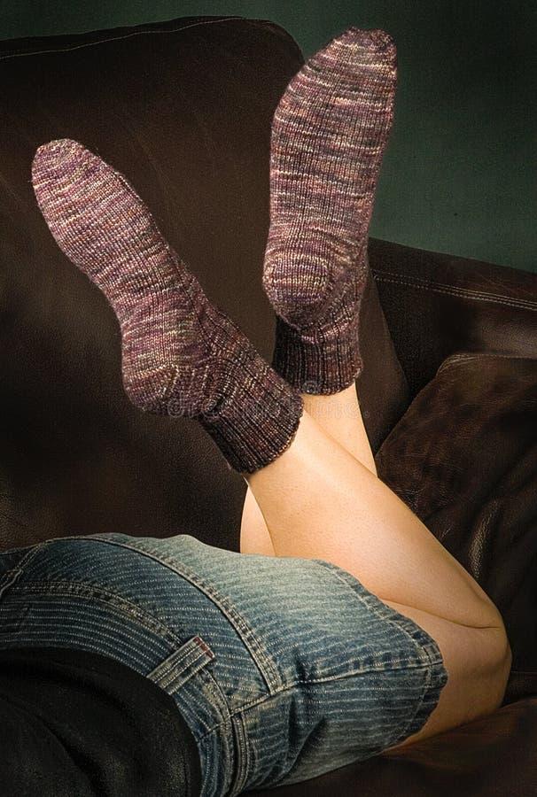 Womens feet in socks royalty free stock image