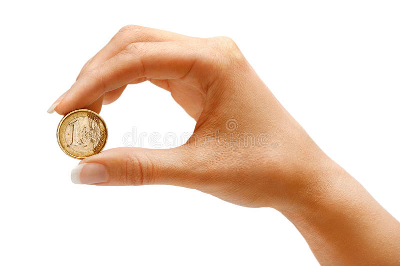 Womens hand holding a coin one euro. On white background. Business concept stock photos
