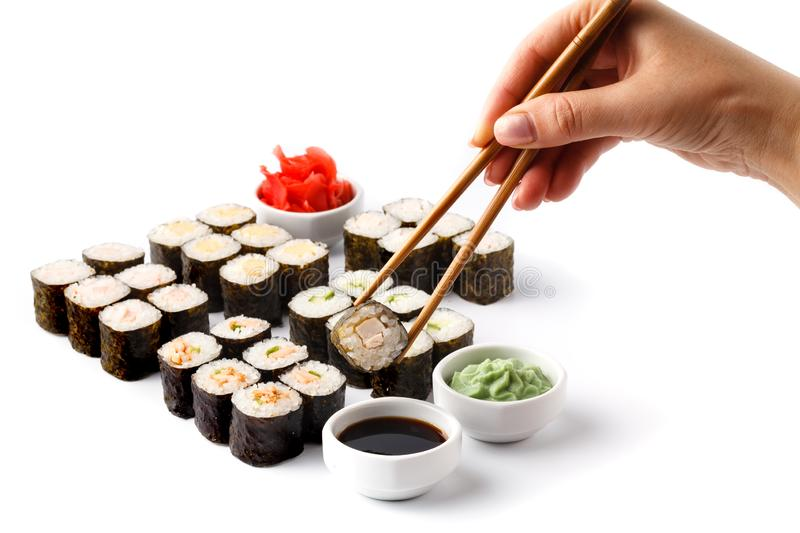 Womens hand holding wooden sticks Philadelphia and california roll royalty free stock images
