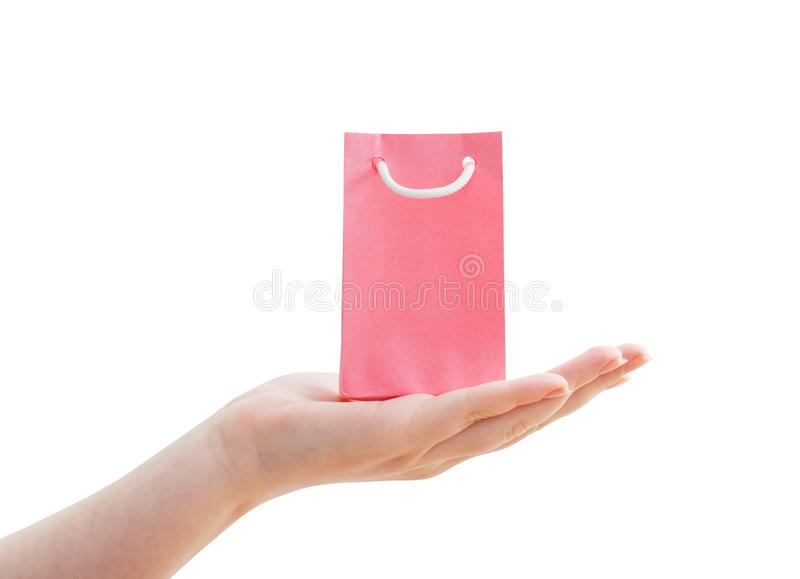 Womens hand with paper bag isolated on white stock image