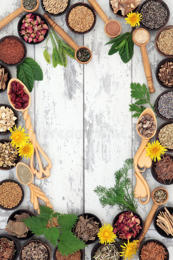 Womens Herbal Health. Herbal medicine selection for women forming a background border over distressed wooden background stock photography