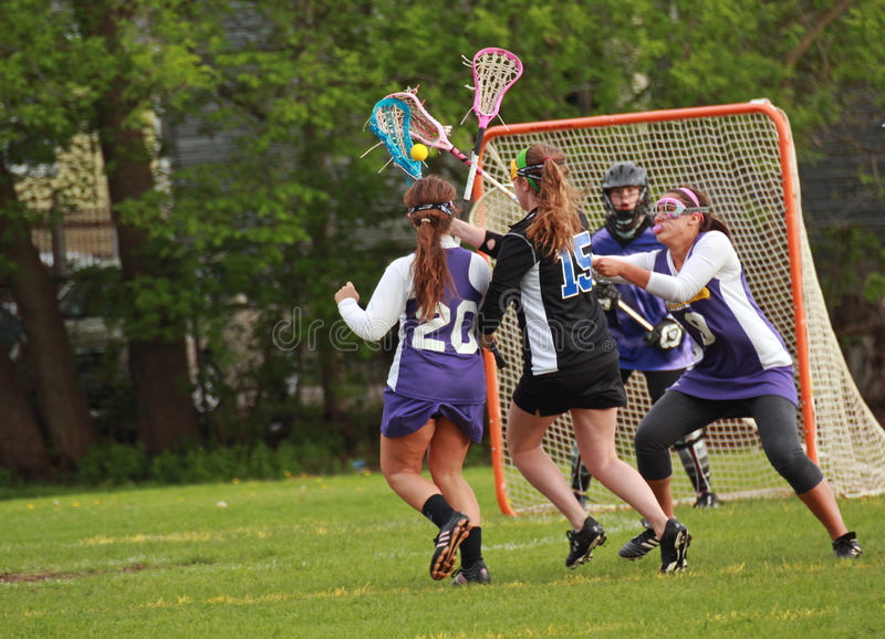 Womens Lacrosse. Waukesha attack player trying to make a goal. This is a Girls Varsity Lacrosse game on May 18, 2011 in Waukesha, WI, between Waukesha West HS stock images