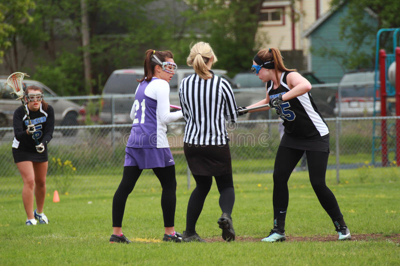 Womens Lacrosse. Mid players begin game with a draw, after Waukesha scored a goal. This is a Girls Varsity Lacrosse game on May 18, 2011 in Waukesha, WI, between royalty free stock photos
