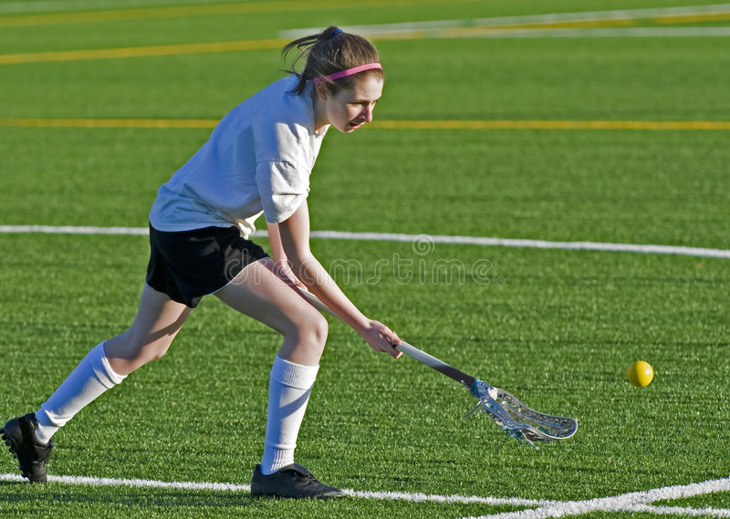 Womens Lacrosse reaching for the ball royalty free stock images