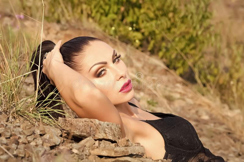 Womens secrets. Sensuality young brunette royalty free stock photos