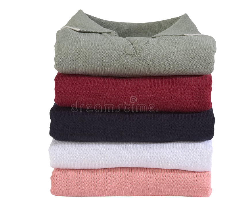 Womens shirts, golf attire. Stack of womens shirts, basically worn as golf attire, sporty royalty free stock photography