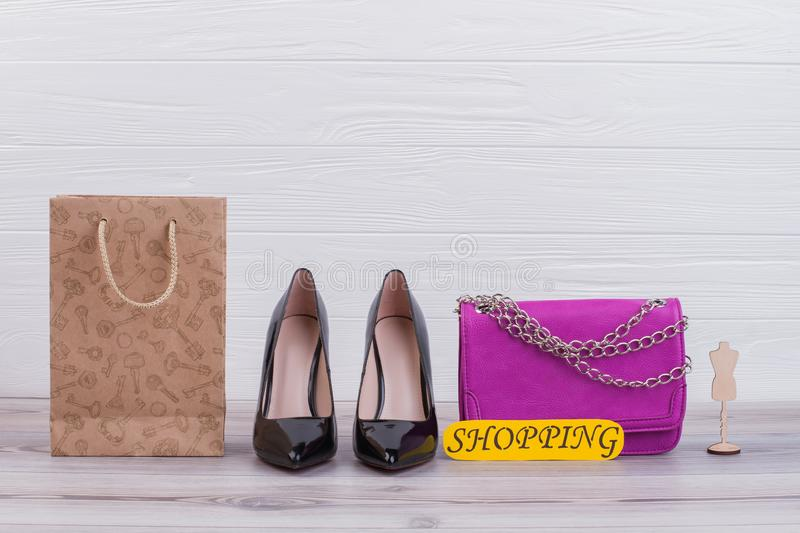 Womens shoes, handbag and shopping bag. Female fashion and shopping concept. Retail therapy for women stock photo