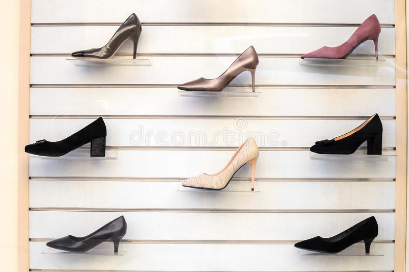 Womens shoes on shelves. Collection of shoe display in store window for sale stock images
