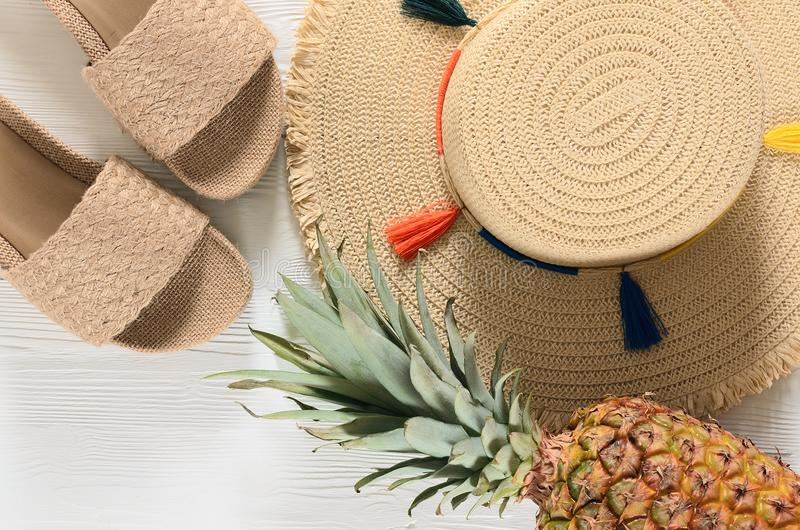 Womens summer accessories straw hat, flip flops, pineapple on stock images