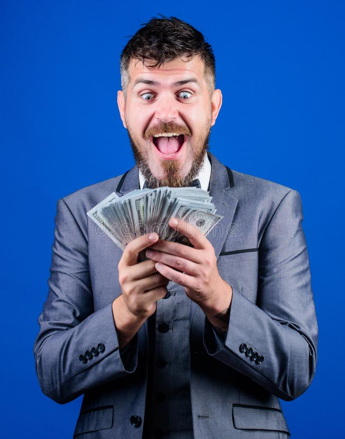 Won a cash prize. Bearded man holding cash money. Making money with his own business. Business startup loan. Rich. Businessman with us dollars banknotes stock photography