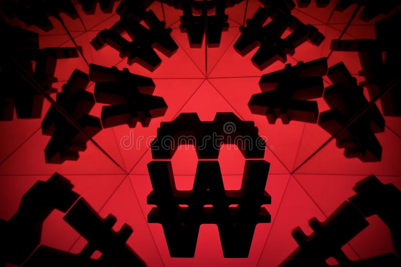 Won Currency Symbol With Many Mirroring Images of Itself. South Korean Won Currency Symbol With Many Mirroring Images of Itself on Red Background royalty free stock photos