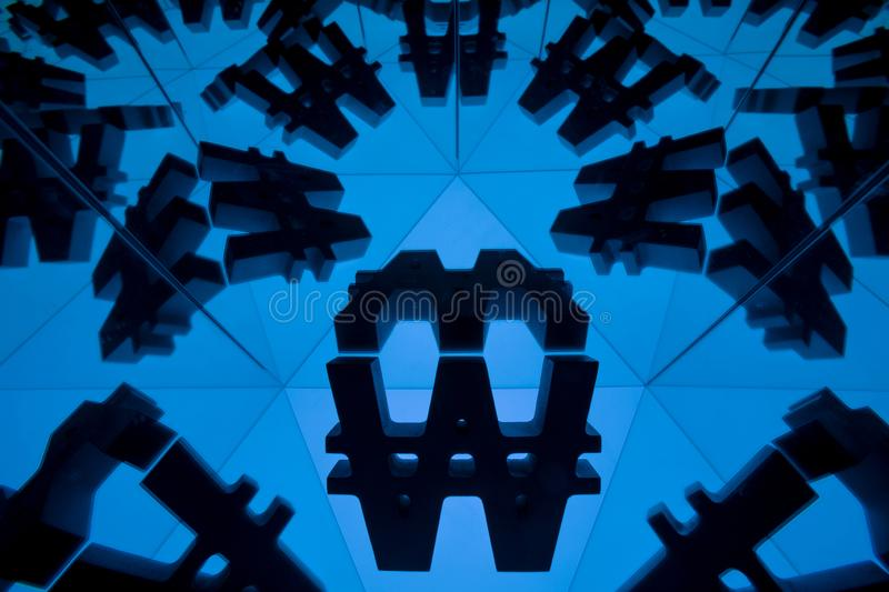Won Currency Symbol With Many Mirroring Images of Itself. South Korean Won Currency Symbol With Many Mirroring Images of Itself on Blue Background royalty free stock photography