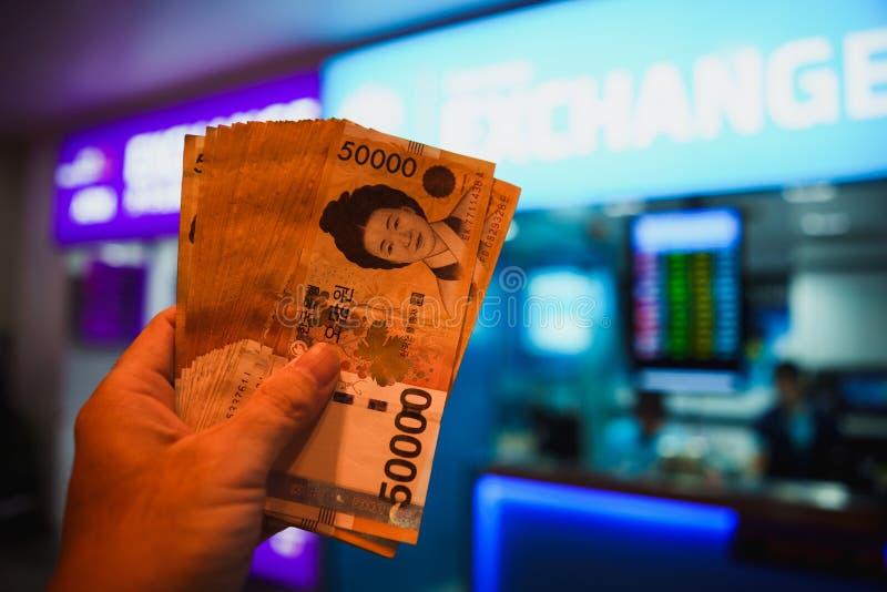 Won. Hand holding Won, South Korea Money royalty free stock image
