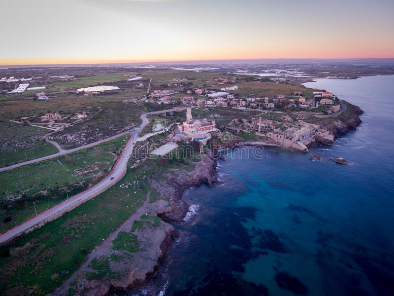 Sunset aerial view of the coastline of Portopalo and the Tafuri castle, Sicily, Italy stock photography