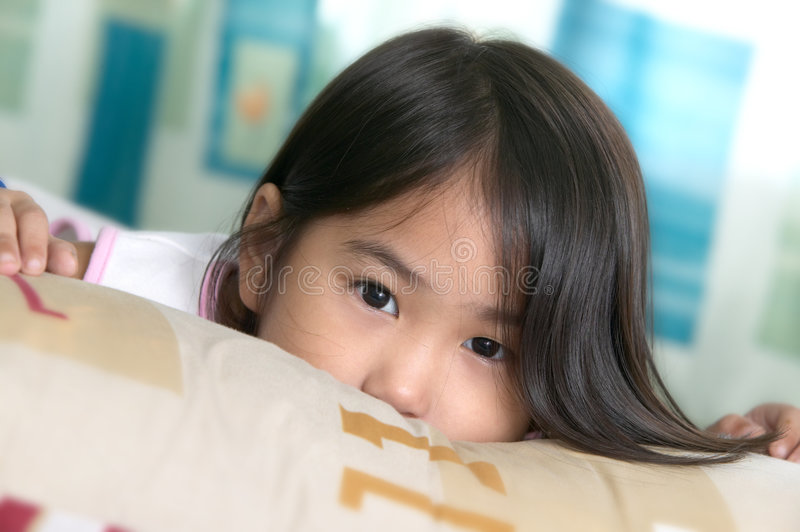 Wonder girl. Little girl with a boring look royalty free stock image