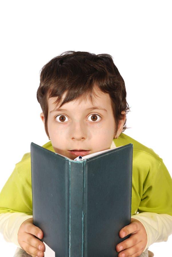 Wonder kid reading book royalty free stock image