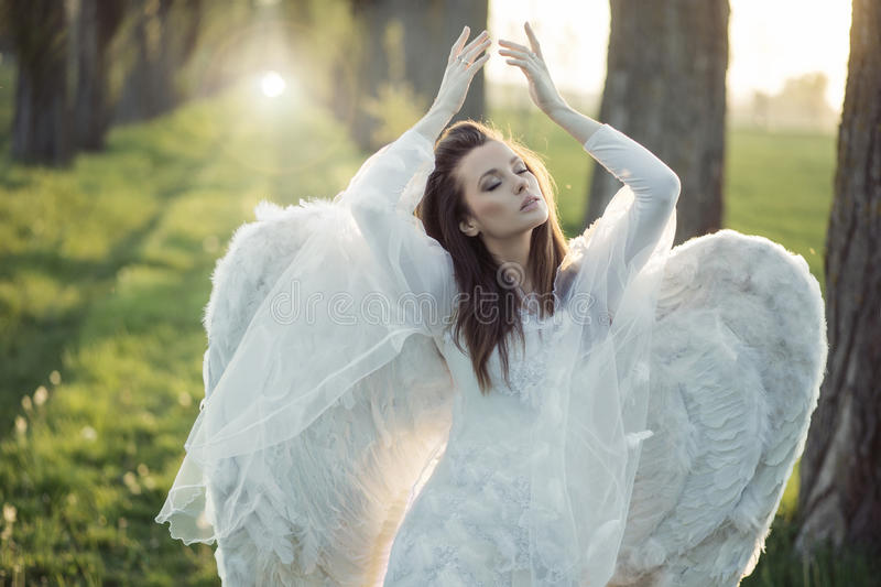 Wonderful angel dancing in the forest stock photo