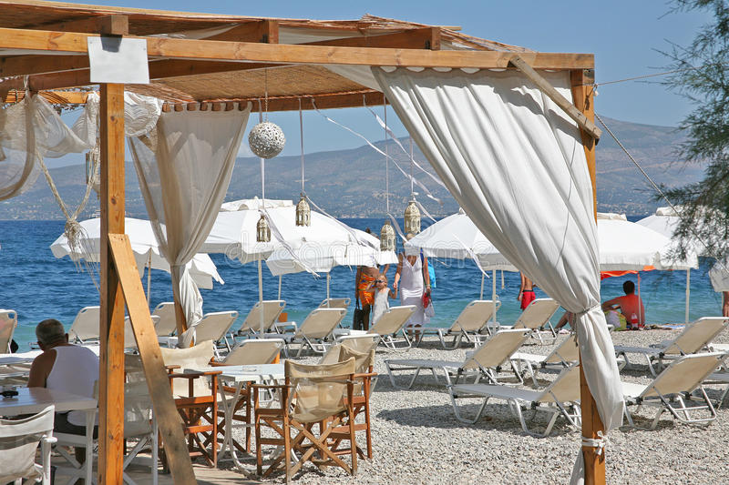 Wonderful beaches of Greece. The cleanest pebble beaches of the Adriatic and Aegean delight and attract thousands of tourists each year. The cozy cafe of royalty free stock images