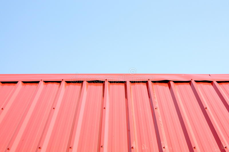 A wonderful blue sky behind Metal roof surface stock photography