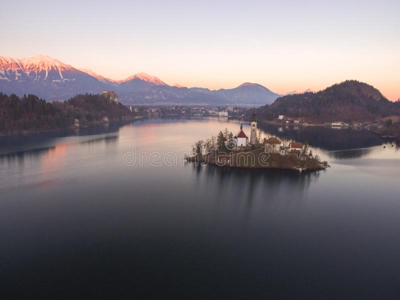 Wonderful Bright Autumn landscape during sunset. Awesome Fairy tale lake Bled in Julian Alps, Slovenia, Europe. royalty free stock photos
