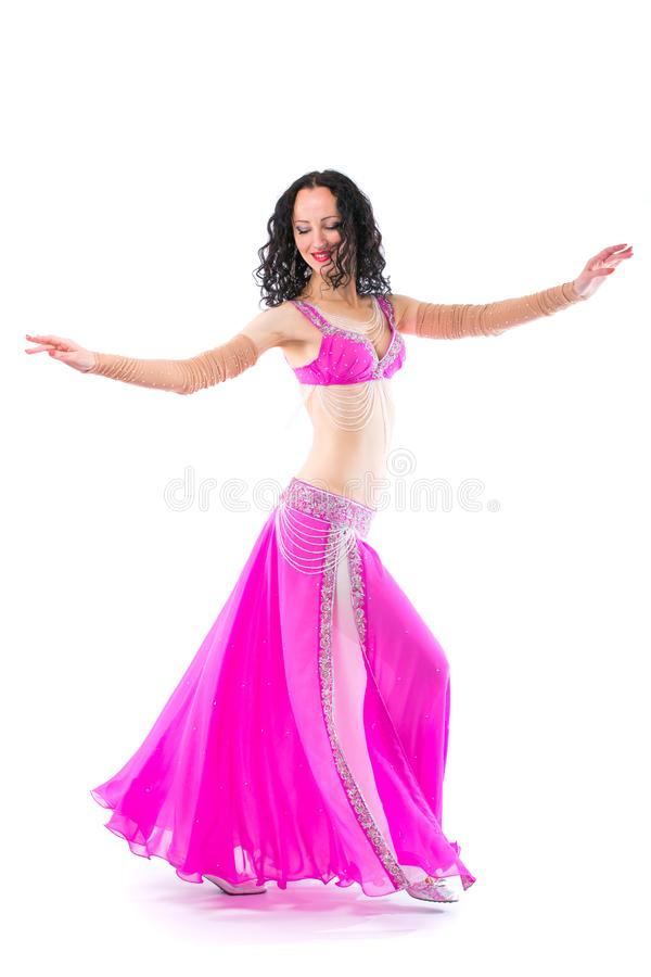 Wonderful brunette in the pink dress of an oriental dancer royalty free stock photos