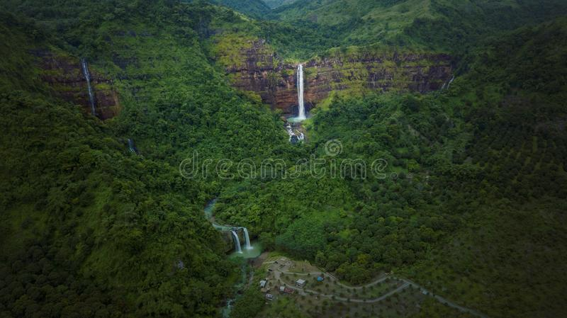 Wonderful Cimarinjung waterfall at Sukabumi. Top view of wonderful Cimarinjung waterfall landscape in the tropical forest at Sukabumi, Indonesia royalty free stock image
