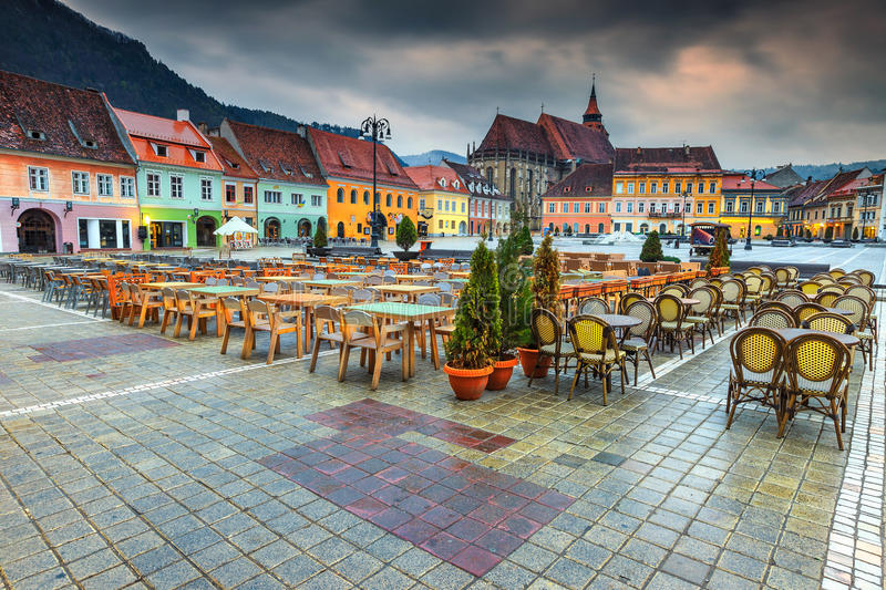Wonderful city center with Council Square in Brasov, Transylvania, Romania. The best Transylvanian touristic town. Beautiful paved city center with street cafe stock photo