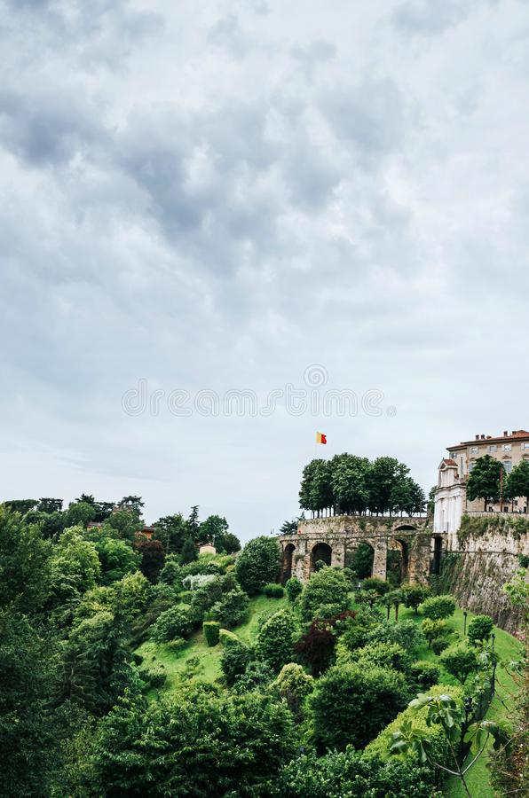 Wonderful city terrace gardens greenery in Bergamo, Italy. Cloudy summer day. Scenic view from old city hill. Beautiful vertical. Travel postcard stock images