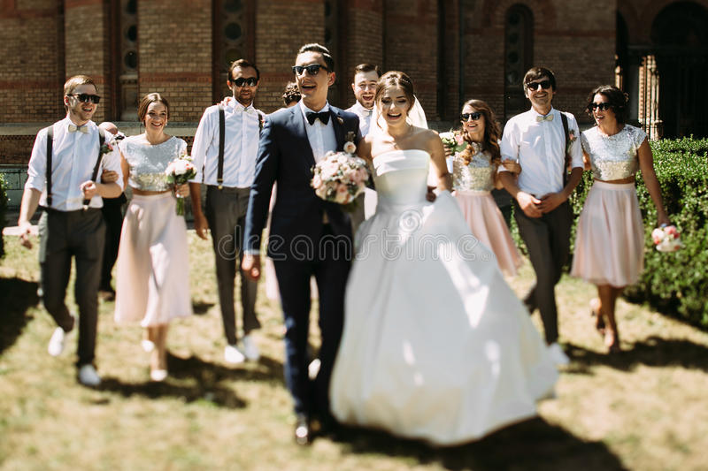 Wonderful couple and their friends behind. A royalty free stock image