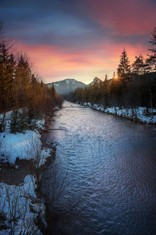 Wonderful evening scenery in winter. Last sun rays over weissach river, germany stock images