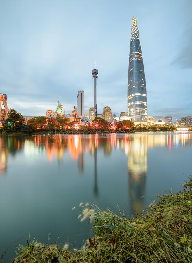 Wonderful evening view of skyscraper reflected in lake, Seoul. Wonderful evening view of skyscraper reflected in lake at downtown of Seoul in South Korea royalty free stock images