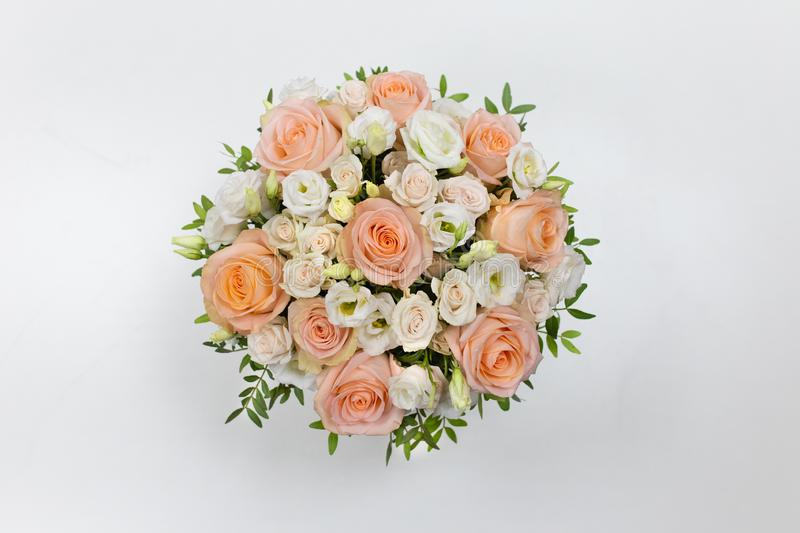 Wonderful flower arrangement in a hat box on a light background. Flowers: Rose, Eustoma. Colors: white, pink, beige stock image