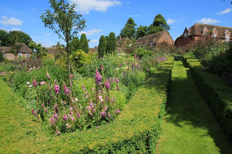 Wonderful garden and in the distance cottages in the beautiful summer. royalty free stock photos