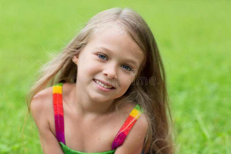 Wonderful girl seven years. For a walk in the park royalty free stock photo