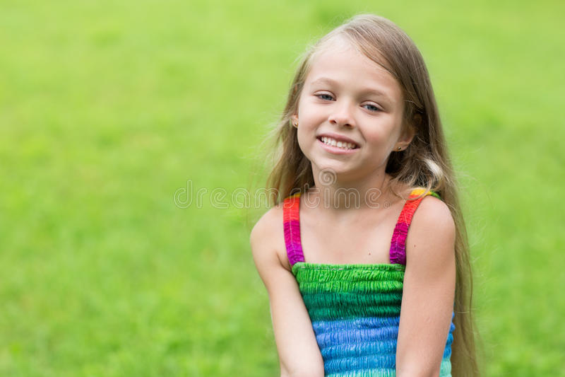 Wonderful girl sitting on the lawn royalty free stock photos